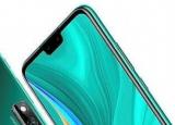 GSMArena发布的照片中可以看到这款手机机身为绿色配色